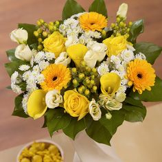 Venus - A stunning bouquet featuring sunny yellow Calla Lilies, cream Lisianthus and bright yellow Roses.