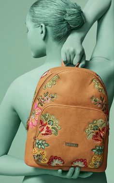 ec92205a6e8 This Desigual camel backpack with rounded finishes and embroidered Indian  floral art is perfect as accessory