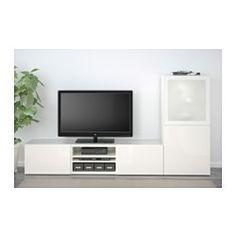 IKEA - BESTÅ, TV-Komb. mit Vitrinentüren, weiß/Selsviken Hochglanz/Frostglas weiß, Schubladenschiene, sanft schließend, , Schubladen und Türen schließen langsam und geräuschlos dank integrierter Schnappbeschläge.Die Deckplatte aus gehärtetem Glas schützt die Oberfläche der TV-Bank und verleiht ihr Glanz.Dank mehrerer Öffnungen auf der Rückseite der TV-Bank lassen sich Kabel von Fernseh- und anderen Geräten verdeckt, aber griffbereit ordnen.Dank der Kabelöffnung auf der Oberseite lassen sich…