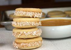 "Delicious alfajores - dulce de leche sandwiched between ""biscuit"" cookies rolled in grated coconut"