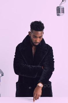 Tinie Tempah wearing Saint Laurent Double-Breasted Faux Fur Coat