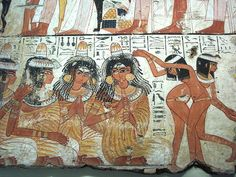 Ancient Egyptian Tomb Art detail, a feast for Nebamun, showing musicians and dancers, painting from the tomb-chapel of Nebamun, accountant in the Temple of Amun (Karnak), circa 1350 BC, Ancient Egypt, panel in the British Museum, London WC1. Full-face images are rare in Ancient Egyptian art.