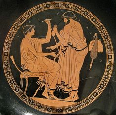 """Man soliciting boy for sex in exchange for a purse containing coins. The inscription reads ΗΟ ΠΑΙΣ ΚΑΛΟΣ (""""The Boy is Beautiful""""). Athenian red-figure kylix, 5th c. B.C. Metropolitan Museum of Art, New York."""