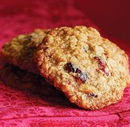 Chewy Cranberry-Oatmeal Cookies -1-1/2 cups flour  & 1 tsp. baking soda   1/2 tsp. table salt   & 1/2 tsp. cinnamon   2-1/2 cups old-fashioned oats   1 cup unsalted butter,   1 cup light brown sugar   1/2 cup granulated sugar   2 large eggs   1 Tbs. honey   2 tsp. vanilla extract   1-1/3 cups cranberries   1 cup walnuts.  Bake 350 for 11 min, let cool on sheet for 5 minutes, then remove from oven.