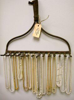 Re-purposed rake as necklace holder.