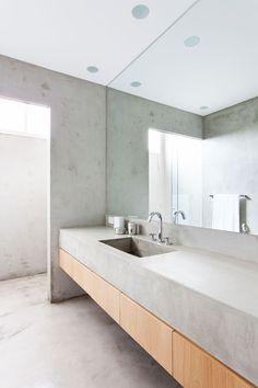 Concrete and wood washroom Apartamento Sergipe by Felipe Hess in São Paulo, Brazil via : Yatzer.com photo © Ricardo Bassetti.