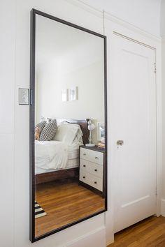 huge floor length mirror next to the door.  opens the room up and convenient for when walking out the door!