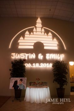 Disney World projection at wedding; donut groom's cake Jamie Heyl Photography
