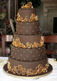 Chocolate & Gold Wedding Cake - My entry in a Chocolate Wedding Cake Contest. Chocolate fondant with chocolate gumpaste scrollwork. I painted the scrollwork with luster dust. Gorgeous Cakes, Pretty Cakes, Amazing Cakes, Quilling Cake, Rodjendanske Torte, Round Wedding Cakes, Cake Wedding, Wedding Bands, Chocolate Fondant