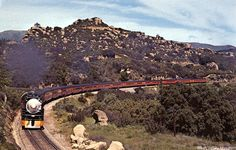 A postcard featuring Southern Pacific Railroad's Coast Daylight (aka Southern Pacific No. 99), moving northbound near Chatsworth, circa 1940. The Coast Daylight operated between Los Angeles and San Francisco from dawn to dusk. West Valley Museum. San Fernando Valley History Digital Library.