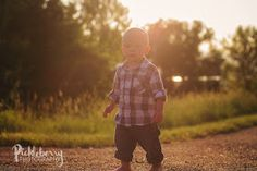 1 year old photo session at sunset in a field. Golden hour photography