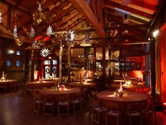 A beautiful rustic wooden room comes alive with uplighting, pin spotting, and a holiday ceiling treatment