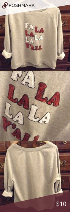 FA-LA-LA sweatshirt (ugly Christmas style)  Sequin detail sweatshirt that adds just the right amount of bling. Red and white sequin letters. Only worn one time so this is in excellent condition. Smoke free and oversized in fit. Bust measures 23 inches laid flat. Hips are 22. Length is roughly 24.5 inches. This is a great holiday piece and doubles great as an ugly Christmas sweater! Questions? Ask me! Offers welcome. Bundle and save 20% on 2 or more items. Custom bundles may also be…