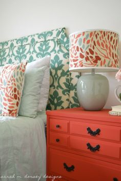 I like the color on this night stand but would definitely change the handles. Bedroom. Color scheme coral and blue.