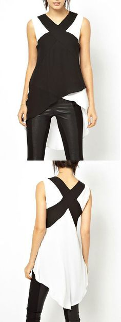 Contrast Color Cross High Low Blouse. Super cute, wish it crossed over in the back instead of being longer though