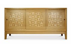 Sideboard in European oak with sycamore relief pattern.