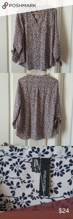 Maurices Large Perfect Blouse This is an almost NWT Maurices Perfect Blouse. The price tag is missing, but the extra button tag is still there. It has a zipper front with to pockets. Maurices  Tops Blouses