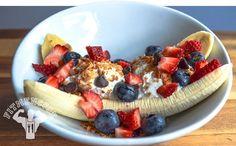 Breakfast banana split - banana, yogurt, strawberries, blueberries, granola, chocolate chips