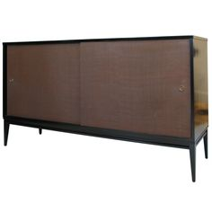 Classic Paul McCobb Ebonized Birch & Grasscloth Credenza | From a unique collection of antique and modern credenzas at http://www.1stdibs.com/furniture/storage-case-pieces/credenzas/