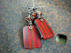 Elegant & earthy, these red stone slab earrings feature hand cut tabbies.... $55.00