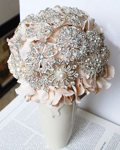 Still love brooch bouquets! I like how this can integrate your wedding colors