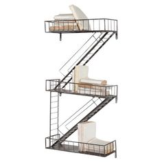 Stylist's Tip: Always on the lookout for new ways to stow an ever-growing book collection? This staircase-style shelf takes the cake. Its distinctive design ...