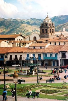 Plaza de Armas, Cuzco, Peru. This plaza was known as the Square of the warrior in the Inca era. The Spanish built stone arcades around the plaza which endure to this day. The main cathedral and the Church of La Compañía both open directly onto the plaza. (V)