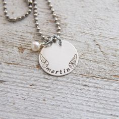 A little token to wear around your neck to remember a loved one. A sterling silver disc is hand stamped with the name you'd like along with our exclusive angel wings.