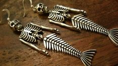 Check out this item in my Etsy shop https://www.etsy.com/uk/listing/470791444/skeleton-mermaid-earrings-dangle-drops