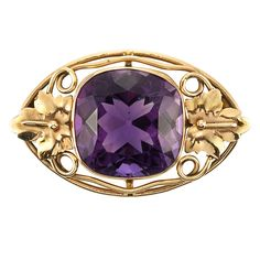 Arts and Crafts Gold and Amethyst Brooch   14 kt., one cushion-shaped amethyst ap. 40.00 cts., c. 1900, ap. 8.3 dwt.
