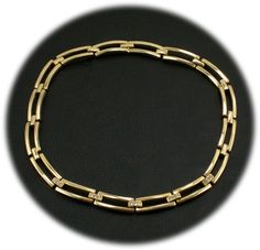 Golden link necklace with rhinestones $52 http://www.vintagecostumejewelryaddiction.com/vcja3589.html