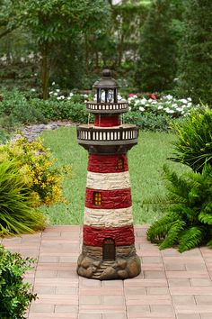 Spruce up your outdoor space with our Lighthouse Fountain! Solar light included.