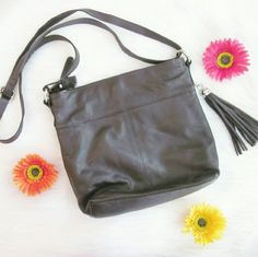 "Chocolate leather tassle crossbody Like new condition! 10"" ? 11"" ? 2.5  Bundle for best deals! Hundreds of items available for discounted bundles! You can get lots of items for a low price and one shipping fee!  Follow on IG: @the.junk.drawer Great American Leatherworks Bags Crossbody Bags"