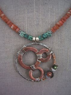 Industrial Evollution-Sunstone necklace with mixed metals