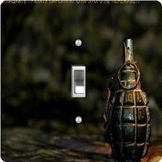 """Rikki KnightTM Grenade on Grunge - Single Toggle Light Switch Cover by Rikki Knight. $13.99. Glossy Finish. For use on Walls (screws not included). Masonite Hardboard Material. Washable. 5""""x 5""""x 0.18"""". The Grenade on Grunge single toggle light switch cover is made of commercial vibrant quality masonite Hardboard that is cut into 5"""" Square with 1'8"""" thick material. The Beautiful Art Photo Reproduction is printed directly into the switch plate and not decoupaged which..."""