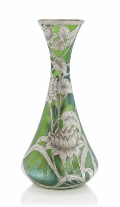 A LOETZ IRIDESCENT GLASS VASE WITH SILVER OVERLAY - CIRCA 1900