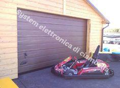 Porta Sezionale da garage finitura esterna finto legno Go-kart Vignanello (VT)