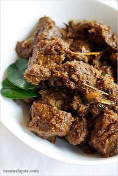 """Indonesian Beef Rendang (Rendang Daging) recipe - (Pinner described it as """"a rich and tender coconut beef stew which is explosively flavorful,"""" one that is certain to win you over if you taste it. It is well worth the time to make it. Indian Food Recipes, Asian Recipes, Beef Recipes, Cooking Recipes, Beef Tips, Indonesian Recipes, Malaysian Cuisine, Malaysian Food, Malaysian Recipes"""