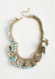 Give us a C! Give us an H! Give us an I! Give us a C! This statement necklace is a cheerleader of moxie, inviting onlookers to join in your celebration of style with its gold chain, metallic threads, and pastel beads. Talk about a vogue victory!