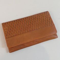 Woven leather Cole Haan clutch  Find more unique consignment pieces at www.revolverboutique.com