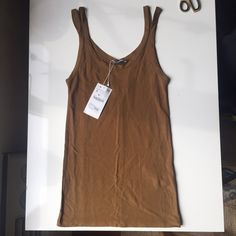Zara NWT Structured Ribbed 70s tank Zara double strap ribbed tank is 70s inspired and perfect for a night out or his rich camel-tan tone works under a jacket at the office. Never worn! NWT Zara Tops Tank Tops