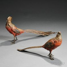 """Pair of Franz Bergman Cold-painted Bronze Pheasants, Vienna, Austria, a male and female, each polychrome painted in yellow, red, and blue, the female stamped """"Nam Greb,"""" vase mark, and """"Made in Austria,"""" the male stamped with vase mark and """"GESCH. 5724,"""" female lg. 13, male lg. 17 3/4 in"""