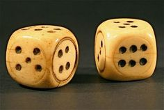 18th 19th Century hand made bone dice game. The sides are marked with numbers or dots so that the number that lands down when the top stops determines the value of the dice.