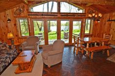 The cozy, 800 square foot interior of Bay Cottage at Four Seasons Resort is bursting with Northwood's charm including knotty log beams and pine walls, log framed doors and windows and distinctive flag stone floor. The living area includes a flat screen TV with Cable TV and DVD player, ceiling fan, phone, sofa sleeper and two comfortable chairs, and a wood burning stone fireplace with beautiful log mantel.  http://4seasonsresort.net/baycottageonlakenamakagon.html