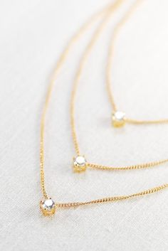 Wahine u'i necklace triple layered gold