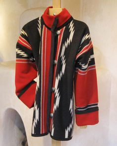 This is the world famous Pendleton Navajo Water scholarship blanket made in my trim fitting hip length Cardigan style. Nice drop shoulder for layering. Deep warm turn-back cuff. Side pockets hidden in the seam. Sizes fit trim. Sizes XXS-L. Please call 575 758 2144 or email aventura@newmex.com to discuss size and availability.