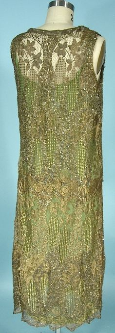 """c. 1926 MADE IN FRANCE Gold Lace and Gold Sequin Dress over Green Silk Original Slip. Gold metallic lace with gold sequins here and there, and the rows of gold sequins create the upsidedown """"A"""" at front and ends in a modified sequin bow at front hipline. Back"""