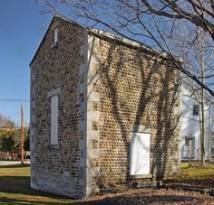 Glacial cobblestones were used in building construction in upstate New York during the middle of the 19th century. Pioneer settlers there cleared their fields of these stones and used them primarily in the construction of homes and foundations for barns. Photo shows the Auburn Railroad Pump House in Fishers, New York (built around 1845). Photographer: Carl Crumley.