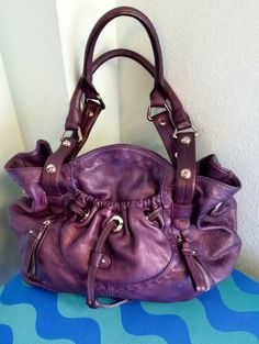 B.Makowsky purple leather purse, $99 + find much more at www.thexchangeclothing.com