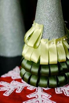 Use a Styrofoam cone, pins, & ribbon to create a Christmas tree.